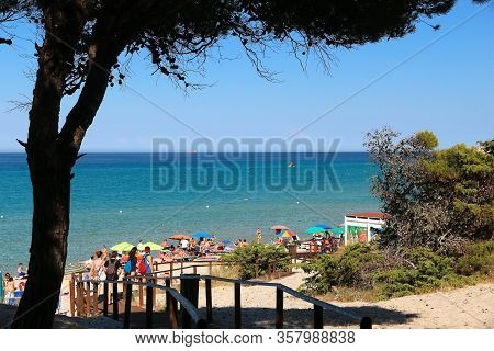 Salento, Italy - June 1, 2017: People Visit Torre Dell Orso Beach In Salento Peninsula, Italy. With