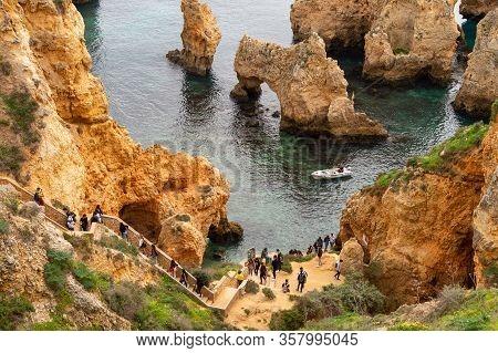 Lagos, Portugal - 4 March 2020: Tourists Visiting Ponta Da Piedade