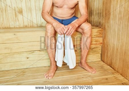 Man sweats relaxed in a sauna for health and wellness