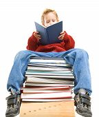 a boy reading on a stack of books poster