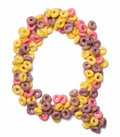 Letter Q Of The English Alphabet From Pink Colored Flakes On A White Isolated Background. Food Patte