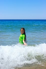 Teen Girl Swimming On Tropical Beach. Child Plays On Ocean Waves. Active Water Sports For Teenager.