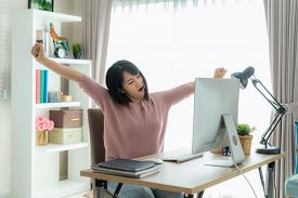 Asian Business Woman Work From Home And Stretching Her Body Because Feel Tired And Sleepyafter Worki