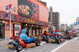 Tokyo, Japan - Mar 16, 2019: Tourists In A Tour Driving Go-kart On The Street Of Tokyo. This Is A Po
