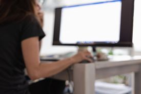 Woman Working On Computer From Home. Busy People Lifestyle. Blurred Image Of Woman Working On Comput