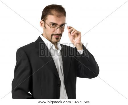 Portrait Of A Young Businessman Standing Against Isolated White Background