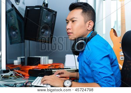 Asian Indonesian musician, producer or mixer in sound studio