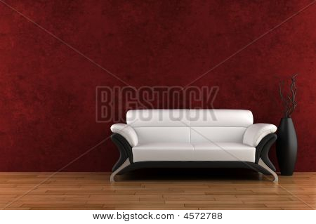 White Sofa And Vase With Dry Wood In Front Of Red Wall