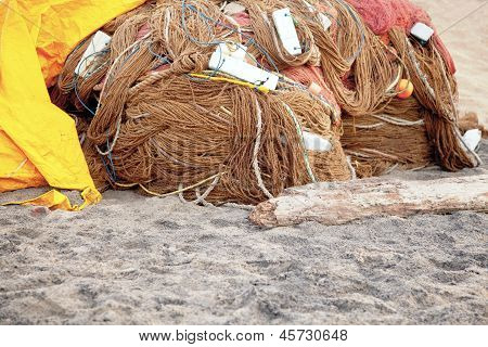 Covering The Fishing Nets Under Tarpaulin