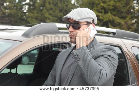 Confident Businessman Talking Over The Mobile Phone