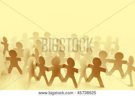 Paper doll people holding hands. Copy space