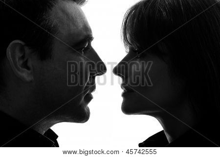 one caucasian couple woman man face to face in silhouette studio isolated on white background