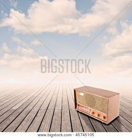 retro radio on pier with sky on sunset
