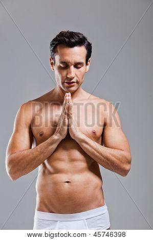 Man In Underwear Prayer Position