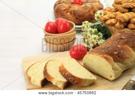 Easter sweet bread with red eggs and shortbread cookies poster