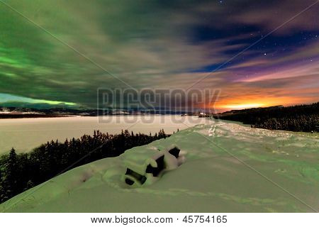 Northern Lights and city light pollution night sky