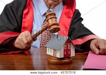 Real estate concept with mini house and gavel