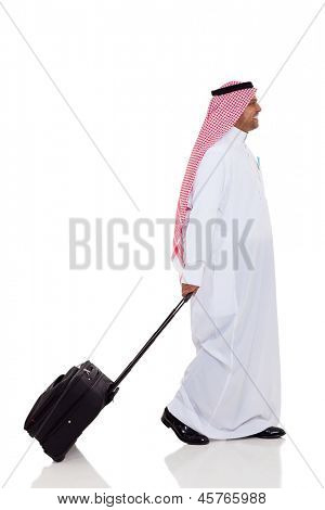 side view of middle eastern business traveller isolated on white