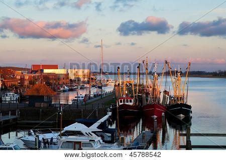 fishing ships in harbor before sunset Zoutkamp Netherlands poster