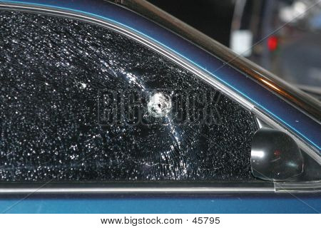 Bullet Holes In Car Window