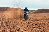 Off road motorbike driving in dirt. Motion dirt flying hight. poster