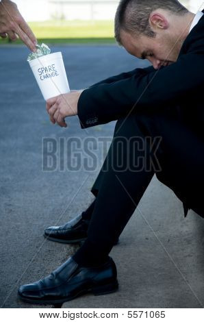 Businessman Begging For Spare Change