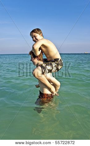 Brothers Enjoy The Clear Warm Water And Playpickaback