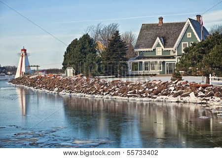 Lighthouse along picturesque waterfront of Charlottetown, Prince Edward Island, Canada. poster