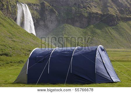 Iceland. South Area. Eyjafjalajokul Zone. Seljalandsfoss Waterfall And Camping Tent.