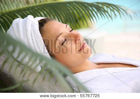 Woman relaxing outside spa resort