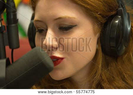 Pretty redhead student hosting a radio show in college