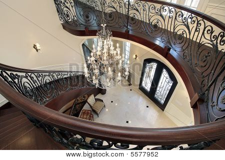 Curved Stairway Leading Down Into Foyer