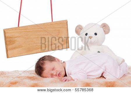 Baby with bear and name board