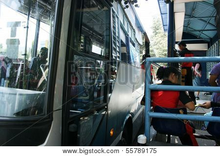 People going by bus