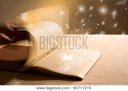 Hand Leafing Through A Book With Blank Pages Magic Light.