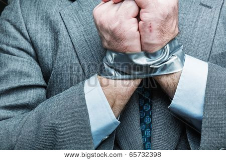 Businessman with hands covered by masking tape