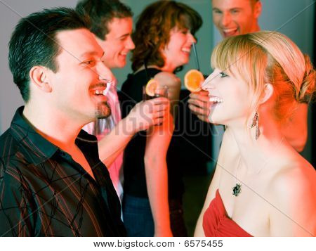 People flirting and drinking in a bar