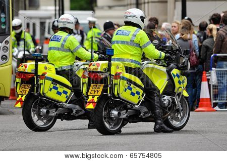 LONDON, UK - CIRCA JUNE 2012: Two police officers on their motorbikes.