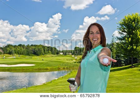 Woman Showing A Golf Ball On The Links