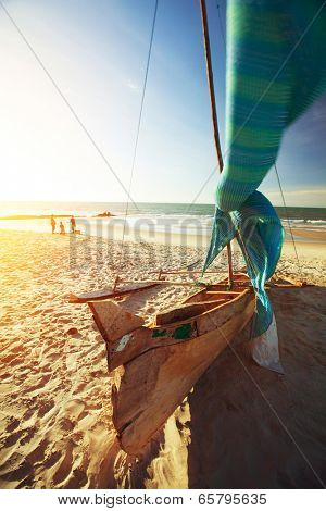 Traditional Malagasy sail boat on sandy beach. Morondava, Madagascar
