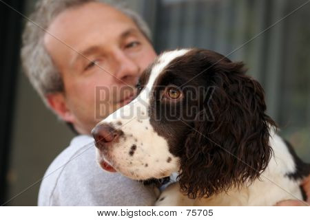 Man holding his dog poster