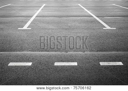 Vacant Parking Place On Gray Asphalt