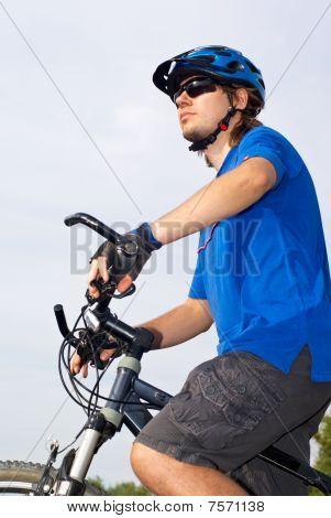 Young Bicyclist In Helmet