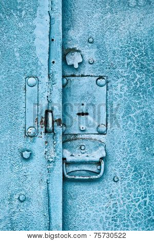 Close up of padlock and old metal hasp on an vintage door