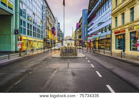 BERLIN, GERMANY - SEPTEMBER 20, 2014: Checkpoint Charlie. The crossing point between East and west Berlin became a symbol of the Cold War.
