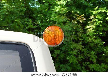 Rear Blinker On Car Roof.