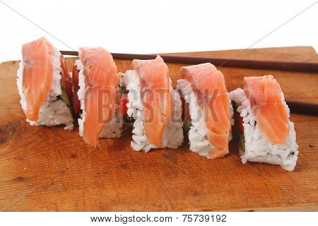 classic onigiri inside out californian sushi rolls with salmon on wooden plate isolated over white background with sticks high resolution hidef
