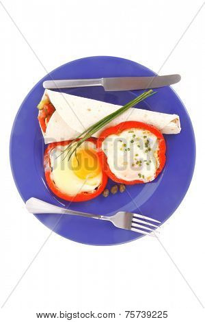fried eggs and tortilla with salad served on blue plate with cutlery isolated over white background high resolution hidef
