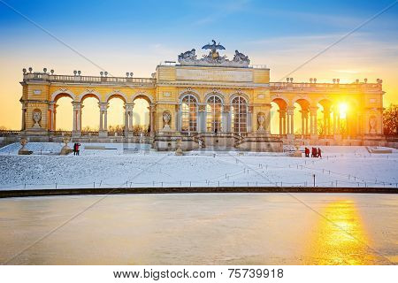 VIENNA - DECEMBER 13 2012: Gloriette in Schonbrunn Palace, Vienna, Austria illuminated by sunset on December 13, 2012. Built in 1775, it was used as a dining hall for emperor Franz Joseph I.