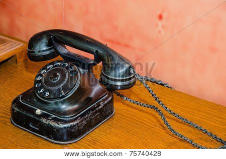 An Ancient Old Black Telephone In A Museum